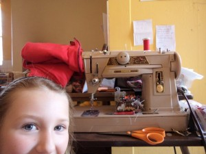 small girl standing by machine 1