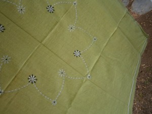 green embroidered tablecloth