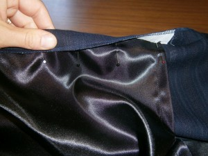 folding the top edge over the lining
