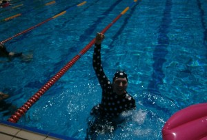 liz haywood in pool after race