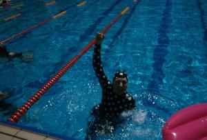 liz haywood in pool after race