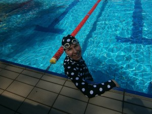 liz haywood in pool wearing spotty bathers