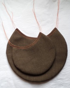pockets with topstitching around tops