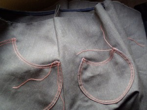 pockets stitched onto skirt