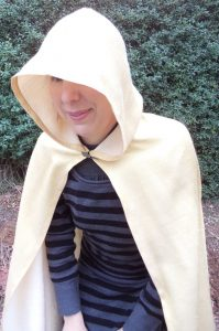 Free pattern dress ups cape gold cape on adult hood closeup
