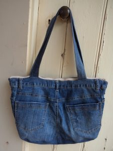 The Jeans Recycling Challenge back view of bag hanging on door