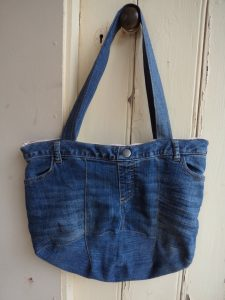 The Jeans Recycling Challenge front view of bag hanging on door