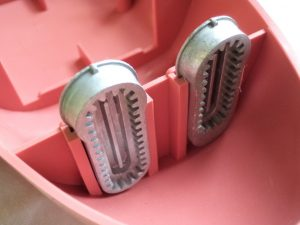 vintage-buttonholes-pink-box-with-cams-sitting-in-it