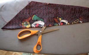 Beautiful trims from old neckties slit the fold