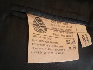 The Aquascutum suit care labels