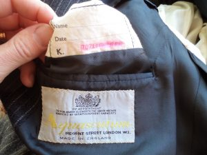 The Aquascutum suit name label