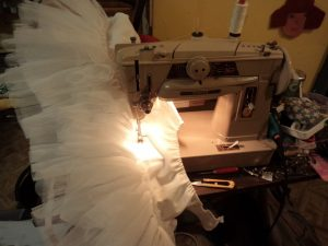 The Haywoods do Fancy Dress sewing the frills