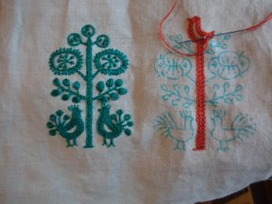 An embroidered interlude bird and tree
