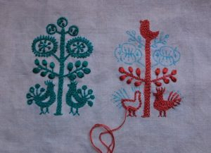 An embroidered interlude bird and tree further along