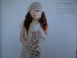 An embroidered interlude girl with oven mitt