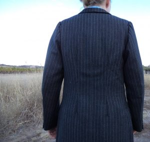 The Aquascutum Suit pinned in sleeves unflattering back view