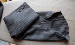 The Aquascutum Suit sleeve removed with pins