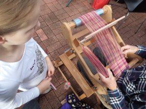 Knitting in Public watching weaving
