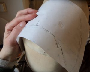 That old dressmakers model making a shoulder piece pattern