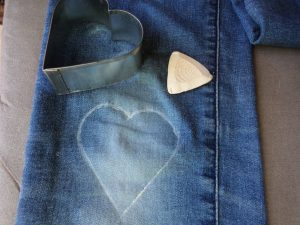 Visible mending heart marking template in chalk