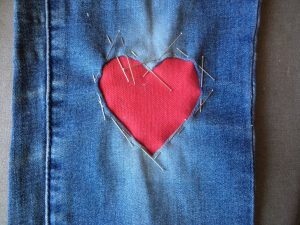Visible mending heart patch pin edges