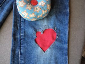 Visible mending heart patch tuck under edges