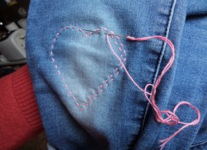 Visible mending heart stitching in pink
