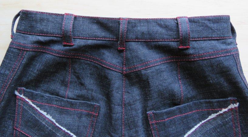 zero waste jeans back jeans laid flat