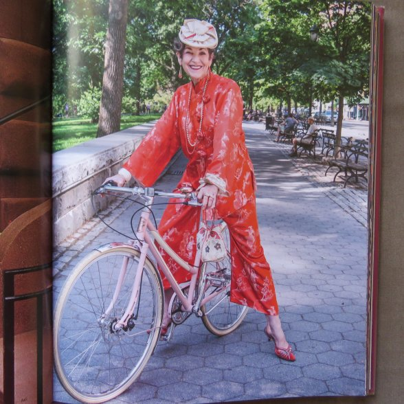 Art of Dressing biking in orange