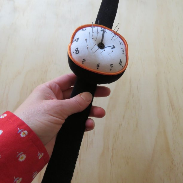 Clock pincushion held