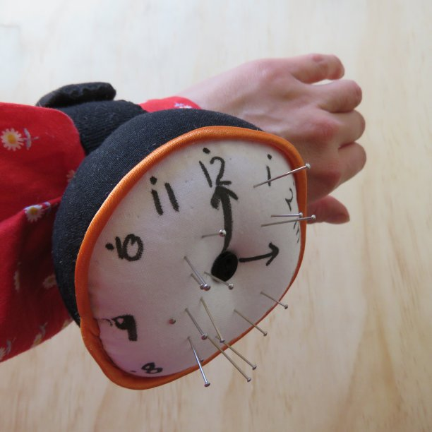 Clock pincushion on wrist 3