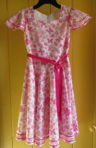 Country show dress on coat hanger