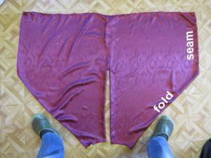 Magi trousers laid flat