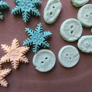Buttons and shapes made from milk plastic