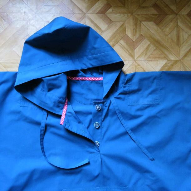 photo of blue poplin hoodie laid flat