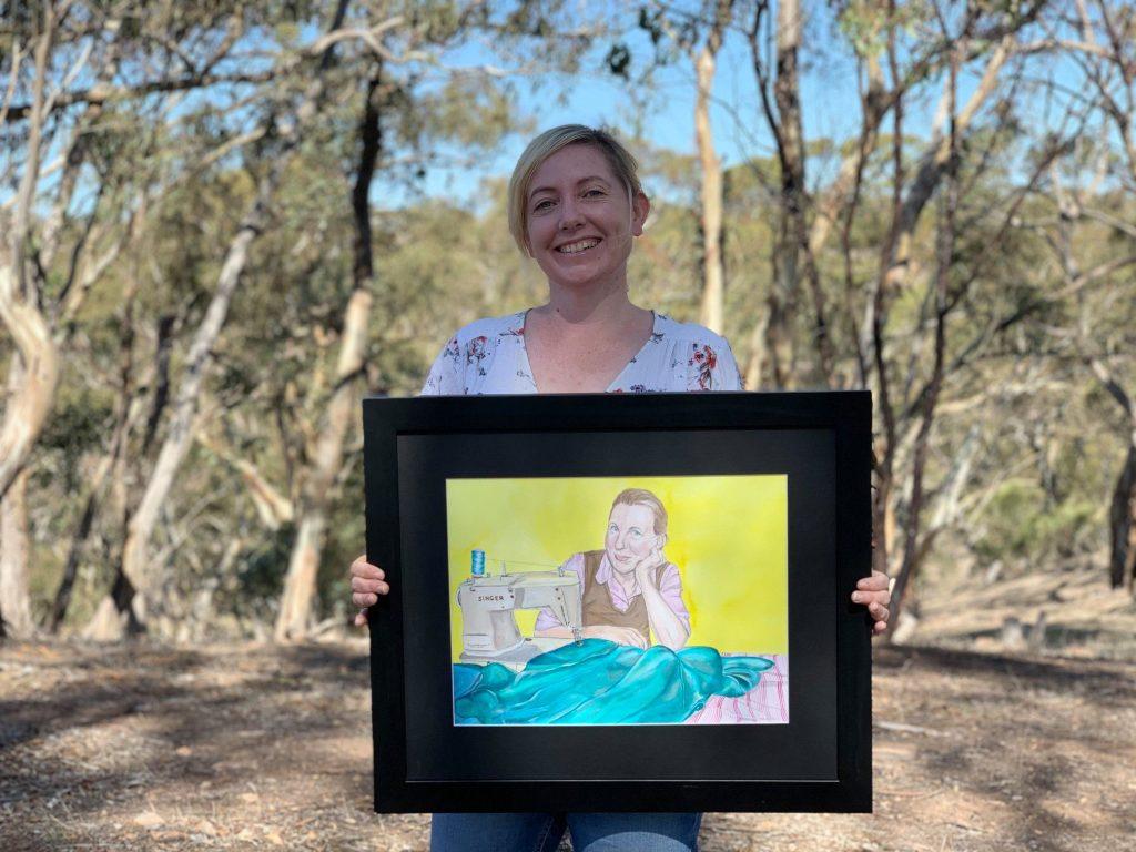 Meg Mader with portrait of Liz Haywood