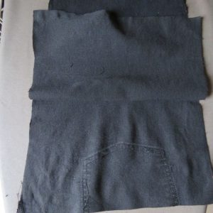 unpicking the back pockets to make a smith pinafore from old jeans