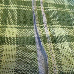 Seam in handwoven fabric