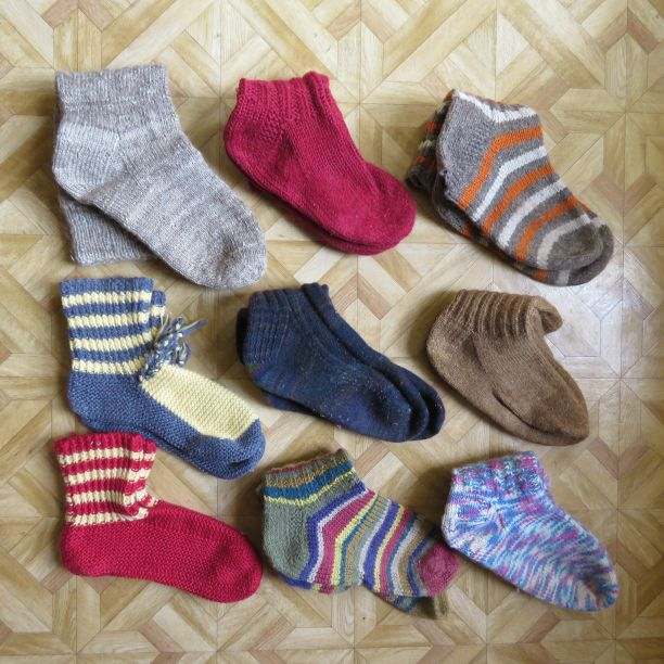 9 pairs of socks with holes in them