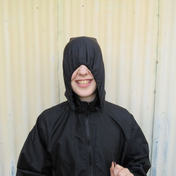 A hood inside a collar with the hood pulled up
